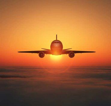 plane flying sunset